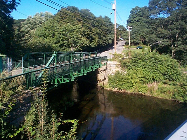 view of the restored Danforth St. bridge - green trestle bridge over the sudbury river