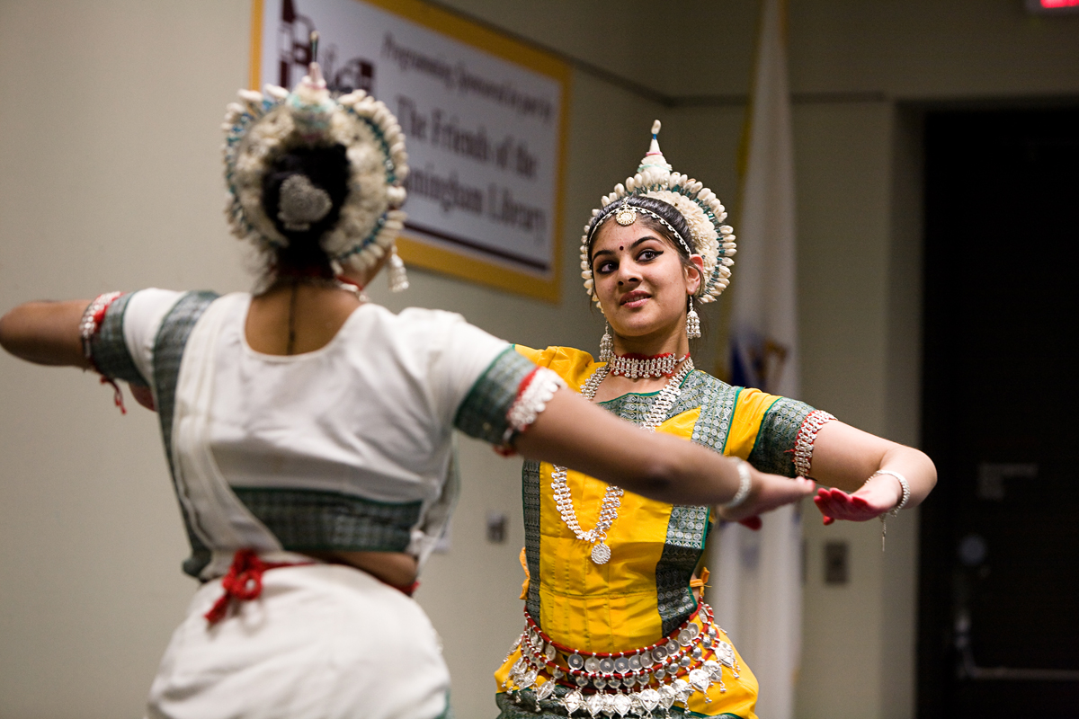picture of indian dancers performing at the Library - two women face each other in colorful costumes