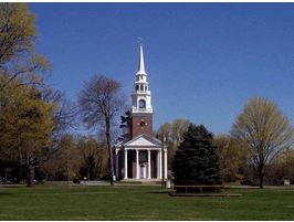 image of a traditional new england church with a brick building and pointed white steeple