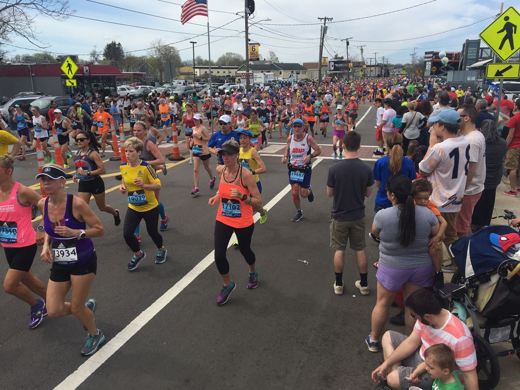view of the mass of runners as the first wave passes through the 6 mile moment in Framingham